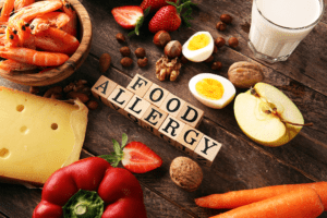 Allergy food concept. Allergy food as almonds, milk, cheese, strawberry, seeds, eggs, peanuts and crustaceans or shrimps